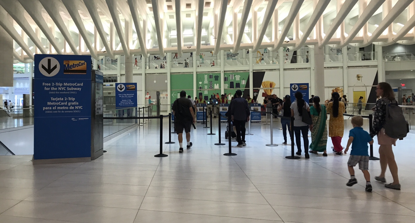 Clear, concise signage directs customers to MetroCard pickup points at World Trade Center.